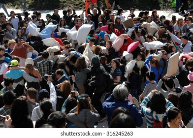VANCOUVER, CANADA - APRIL 7, 2012: Feathers went flying as hundreds of people came armed with their pillows to celebrate the International Pillow Fight Day 2012 in Vancouver, Canada, April 07, 2012.
