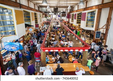 VANCOUVER, CANADA - AUG. 16, 2017: Visitors eating at the Granville Island Public Market. Granville Island is located across False Creek from downtown Vancouver.