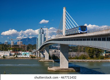 VANCOUVER, CANADA - AUGUST 11, 2016: Canada  Line train passes bridge on August 11, 2016. The Canada Line is Vancouver's new rapid transit rail link connecting airport to downtown Vancouver.