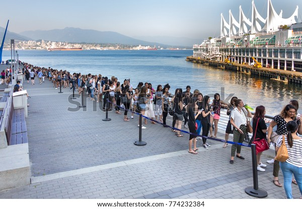 Vancouver, Canada - August 29th, 2017:  Queue of women waiting around three hours in the line to enter to the Aritzia Warehouse big Sale at Vancouver Convention Centre.