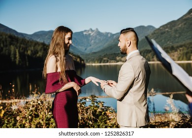 Vancouver, Canada -  Circa 2018. Couple in love getting married at capilano lake park.