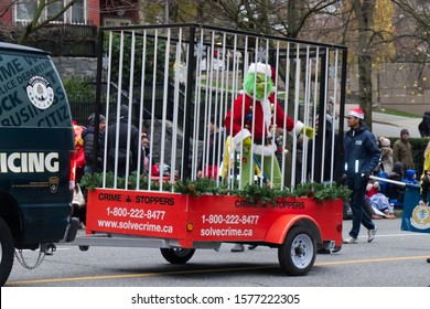 """Vancouver, Canada - December 1, 2019: The character from the famous movie """"How the Grinch Stole Christmas"""" is locked in the Cage during The Santa Claus Parade in Vancouver"""