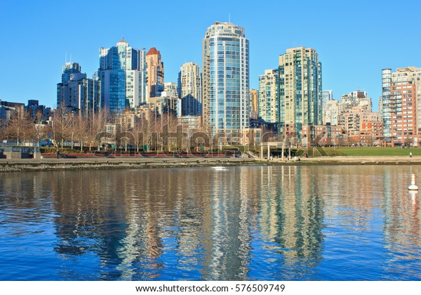 VANCOUVER, CANADA - DECEMBER 8, 2013: The windows of sleek, exclusive condominiums in Yaletown, Vancouver, Canada, reflect the morning sun.