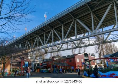 Vancouver, Canada - Feb 1, 2019 : View of Granville Island Public Market next to Granville Bridge in Vancouver BC