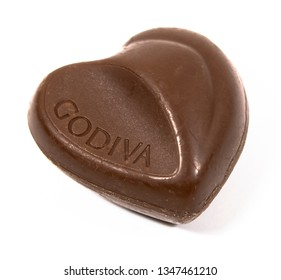 VANCOUVER CANADA - FEBRUARY 12, 2019 : Godiva dark chocolate in heart shape with isolated white background. GODIVA Chocolatier is a Belgian manufacturer of premium fine chocolates and related products