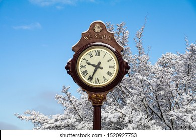 VANCOUVER, CANADA - February 13, 2019: The antique Lion clock with snow coverd tree background in the winter. Big Lions Clock in Queen Elizabeth Park, British Columbia attraction.