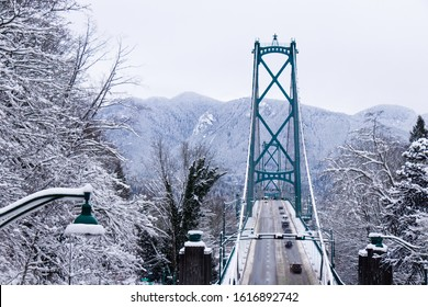 Vancouver, Canada - January 15, 2020: A View of Lions Gate Bridge covered in snow. Snow storm and extreme weather in Vancouver.
