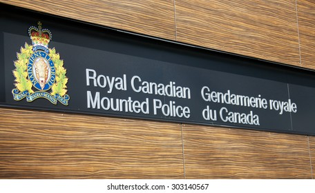 VANCOUVER, CANADA - JANUARY 26, 2015: A sign for the Royal Canadian Mounted Police in English and French along with the crest of the RCMP.