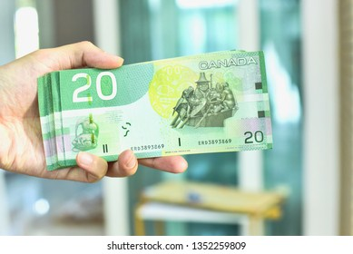 Vancouver, Canada - JANUARY 28, 2019: Hand Holding Canadian Twenty Dollar Banknotes
