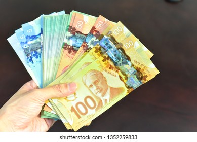 Vancouver, Canada - JANUARY 28, 2019: Hand Holding Canadian Dollar Bills