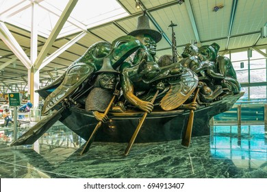 """VANCOUVER, CANADA -JULY 05: The sculpture """"Spirit of Haida Gwaii, the Jade Canoe"""", by Haida artist Bill Reid, is permanently exhibited in the terminal of the International Airport, Vancouver, Canada."""