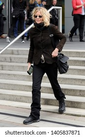 VANCOUVER, CANADA - JULY 12, 2014: Meg Ryan leaves TED Talks conference in Vancouver, Canada wearing sunglasses
