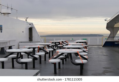 Vancouver, Canada - July 16,2020: Physical distancing concept. BC Ferries workers keep space between seats to avoid spreading COVID-19 on board