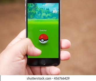 VANCOUVER, CANADA - JULY 22, 2016: Pokemon Go player capturing a Pokemon on a smart phone.
