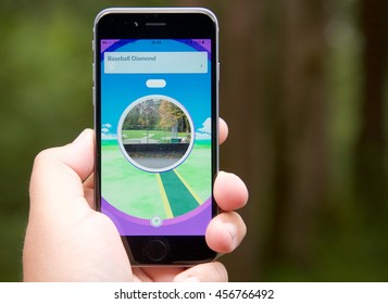 VANCOUVER, CANADA - JULY 22, 2016: Adult playing Pokemon Go on a smart phone. Screen showing a Pokestop