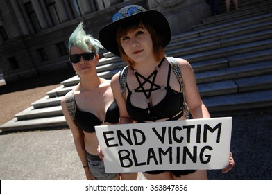 VANCOUVER, CANADA - JULY 7, 2014: Hundreds of women and men marched the streets of downtown during SlutWalk protest against sexual assault in Vancouver, Canada, on July 7, 2014.