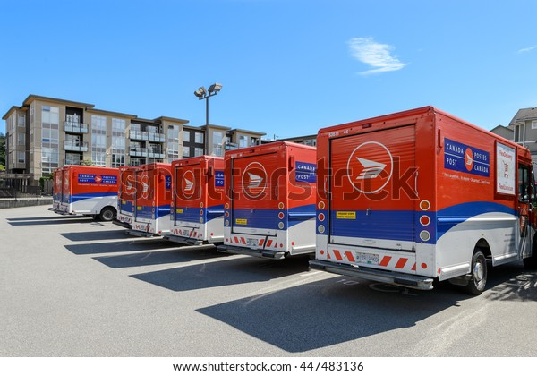 VANCOUVER, CANADA - June 12, 2016: A line of Canada Post trucks on a parking lot of a central office.