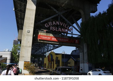 Vancouver, Canada - June 17 2018: Editorial photograph of the sign for Granville island above the road. Granville island is known in Vancouver for trendy markets and street performers