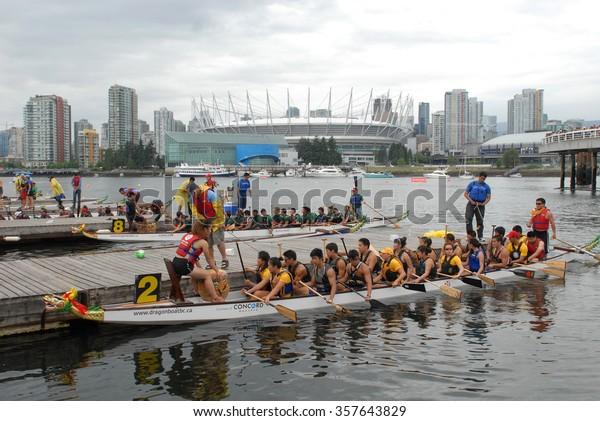 VANCOUVER, CANADA - JUNE 23, 2013: Rowers participate in the annual Rio Tinto Alcan Dragon Boat Festival and Race on June 23, 2013 in Vancouver, Canada.