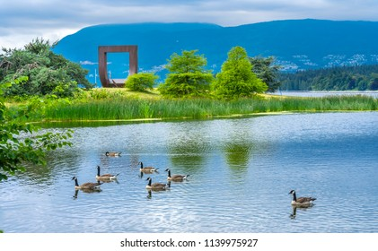 VANCOUVER, CANADA - JUNE 23, 2018 Pond Canadian Geese Gate To The Passage Northwest Square Statue Vanier Park Vancouver British Columbia Canada Pacific Northwest. by Alan Chung Hing in 1980