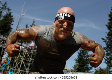 VANCOUVER, CANADA - JUNE 6, 2015: Competitors participate in the 2015 Spartan Race obstacle racing challenge in Vancouver, Canada, on June 6, 2015.
