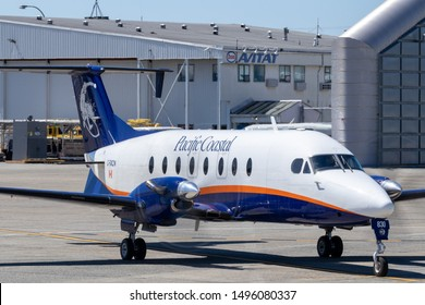 VANCOUVER, CANADA - May 10, 2019: Pacific Coastal Beechcraft 1900 leaving south terminal at Vancouver Intl. Airport.