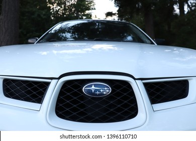 Vancouver,  Canada – May 12, 2019: Front end of a white 2006 Subaru Impreza on a forest road