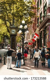 "VANCOUVER, CANADA - MAY 16, 2007: Tourists gather around Steam Clock in Gastown, Vancouver's first downtown core is named after ""Gassy"" Jack Deighton, who in 1867 opened the area's first saloon."