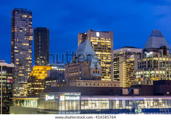 VANCOUVER, CANADA - MAY 20, 2016: Rooftops of high-rise buildings and skyscrapers and Pacific Centre in Downtown Vancouver at night