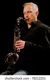 """VANCOUVER, CANADA - MAY 27: Jennifer Scott Sextet performs """"Brasiliera"""". Cory Weeds (sax) on the stage of The Jazz Cellar on May 27, 2011 in Vancouver, Canada."""
