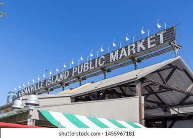 VANCOUVER, CANADA - May 7, 2019: Granville Island Public Market sign across the top of the main market building on clear day.