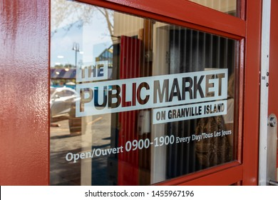 VANCOUVER, CANADA - May 7, 2019: The Public Market on Granville Island sign seen on a door at the main market building.