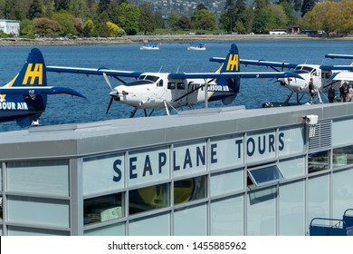 VANCOUVER, CANADA - May 8, 2019: Seaplane Tours building at Vancouver Harbour Flight Centre with Harbour Air seaplanes in background.