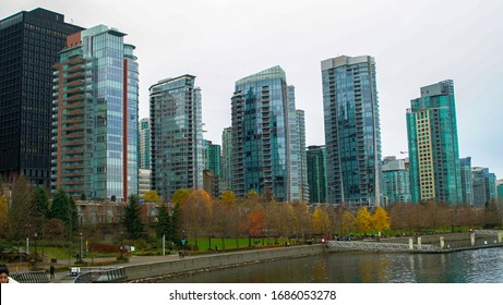 Vancouver, Canada - november 17, 2019: Panoramic view of the most beautiful coal harbour buildings, in a cloudy day.