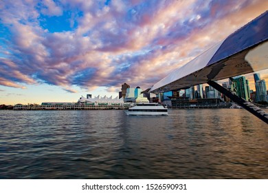 VANCOUVER, CANADA - October 2019: View from the seaplane on Vancouver harbor and port at sunset, British Columbia, Canada