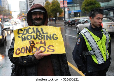 VANCOUVER, CANADA - OCTOBER 23, 2011: Hundreds of people marched the streets to protest against corporate greed, as part of global Occupy movement, in Vancouver, Canada, Oct.23, 2011.