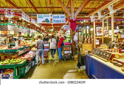 VANCOUVER, CANADA - OCTOBER 7,2017: Customers and sellers in Granville Island Public Market It's home to over 100 vendors offering fresh seafood, meats, sweets specialty foods.