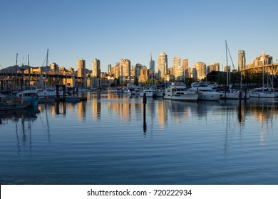 VANCOUVER, CANADA - SEPTEMBER 13, 2016: boats line the marina at Fisherman's Wharf.  Granville Bridge and the Burrard Street Bridge are visible. Vancouver skyline in background.