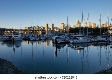 VANCOUVER, CANADA - SEPTEMBER 13, 2016: boats line the marina at Fisherman's Wharf between Granville Island and the Burrard Street Bridge.