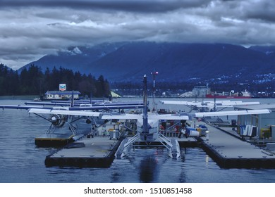 Vancouver, Canada - September 19, 2019: View of Vancouver Harbour Flight Centre. Seaplanes on the water with a dark clouds background
