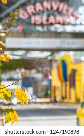 Vancouver, Canada - September 23 2017: Blurred out-of-focus view of the famous neon sign at the entrance of Granville Island in Vancouver, Canada