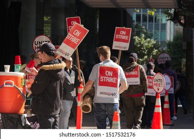Vancouver, Canada - September 27,2019: Activists are walking on Hastings Street in front of Pinnacle Hotel. Striking hotel workers block sidewalk in downtown Vancouver