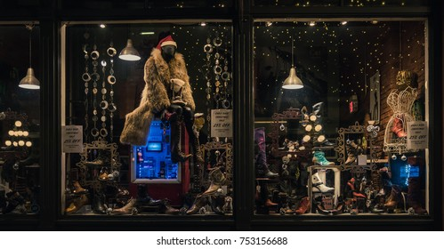 Vancouver Canada,December 2016.clothing on sale with window show backgrounds