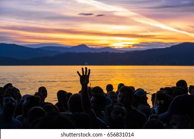 Vancouver Canada,June 6.2017.People dancing to a drum circle on Third Beach,Stanley Park,Vancouver British Columbia,Canada