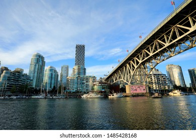 Vancouver City, BC Canada - Jun 11, 2019: The Vancouver waterfront during the sunset time, view from Granville Island in Vancouver City, Canada on Jun 11, 2019