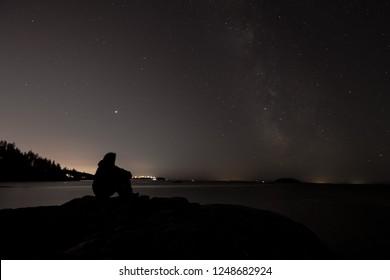 Vancouver city lights versus Milky way. Horseshoe Bay, BC, Canada.