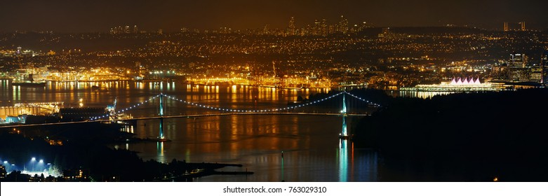 Vancouver city mountain top night view with buildings and bridge.