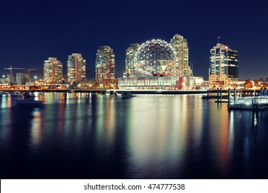 Vancouver city night view with buildings.