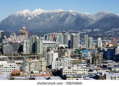 VANCOUVER - DECEMBER 7, 2016: Panoramic view of Vancouver downtown, Yaletown, False Creek and in the bac are Coast Mountains with Grouse Mountains and Seymour. British Columbia, Canada