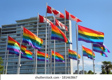Vancouver Gay Pride Flags. Rainbow colored Gay Pride Flags and Canadian Flags flutter in the wind in Vancouver. British Columbia, Canada.